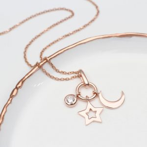Rose gold CZ star and moon pendant